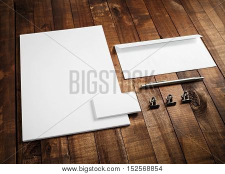 Corporate identity mock up on wooden table background. Blank stationery template. Blank letterhead business cards envelope and pen. Responsive design mock-up for branding identity.