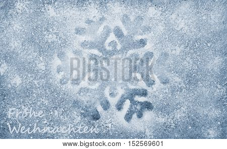 Snowflake, grey fiber fabric, blue glitter film and the words Frohe Weihnachten (german words for Merry Christmas)