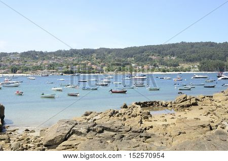 ALDAN, SPAIN - AUGUST 9, 2016: Boats at the sea in the fishing port of Aldan in the province of Pontevedra Galicia Spain.