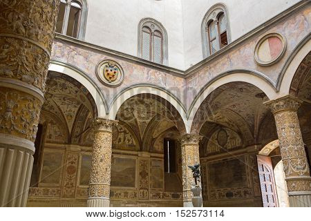 FLORENCE, ITALY - SEPTEMBER 2016 : Interior of Old Palace, Palazzo Vecchio's first Courtyard, town hall of Florence, Italy on September 21, 2016. Frescoes  are cities of Austrian Habsburg monarchy