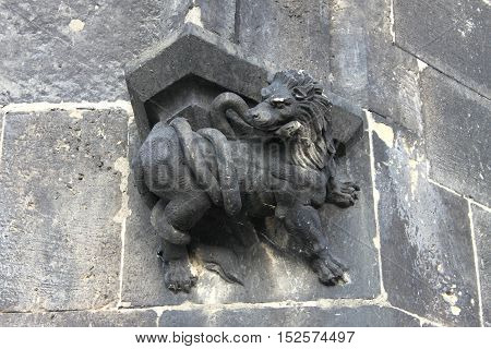 Bas-relief with a lion battling a coiled snake