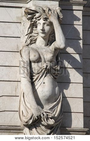 Marble statue portraing a pregnant woman. Symbol of maternity