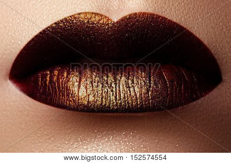 Cosmetics And Make-up. Shoot Of A Beautiful Girl With Golden Lip