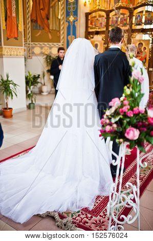 Back of elegant wedding couple at the church