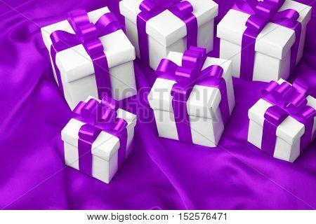 gift on purple satin background. studio shot
