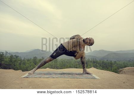 Man Doing Yoga Exercise Concept