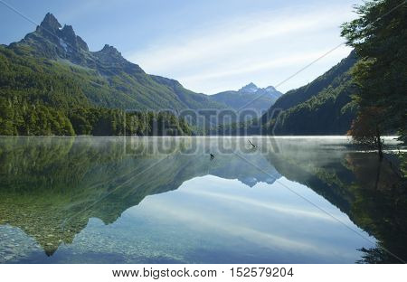 Morning sunrise at misty lake and perfect reflection