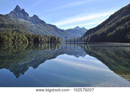 Beautiful reflection at lake Soberanía shot in the morning