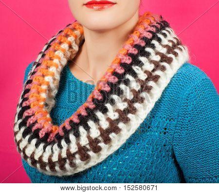 Woolen Scarf. Beige Woolen Scarf Around Her Neck Isolated On Pink Background.