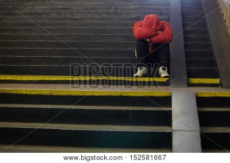young homeless man sleeping on the street poverty city