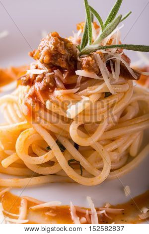 Portion Of Spaghetti With Cheese And Minced Meat With Rosemary