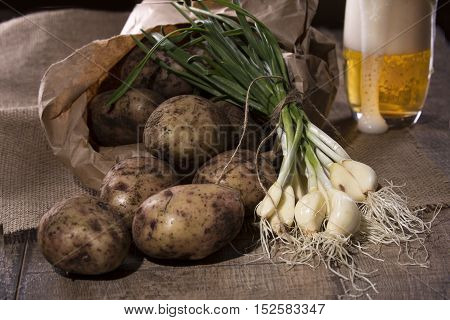 still life of fresh potatoes and garlic