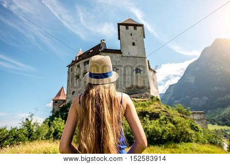 Balzers, Liechtenstein - July 01, 2016: Young female tourist visits Gutenberg castle Balzers town. Gutenberg is one of the five castles of Liechtenstein