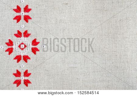 Embroidery Design By Red And White Cotton Threads On Flax. Christmas Background With Embroidery.