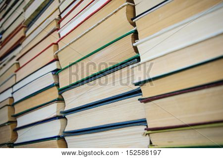 closeup the wall of books on library shelves