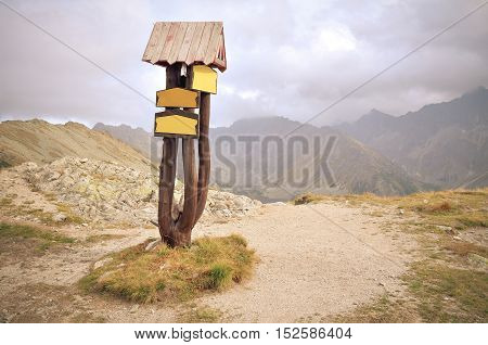 Sign indicating the trail on the mountain pass in High Tatra Slovakia.
