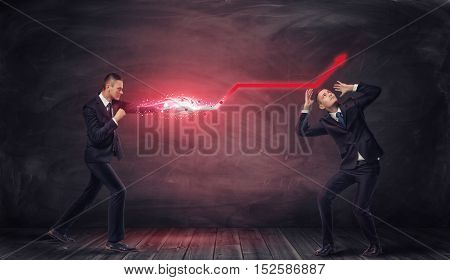 Businessman striking with glowing red arrow in the air with another businessman under it standing in defensive pose looking upwards. Successful administration. Progress and profit.