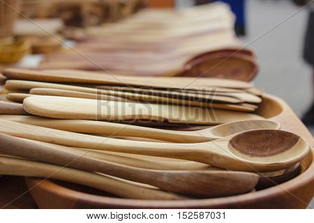 Handmade brown wooden spoons and cutlery at fair