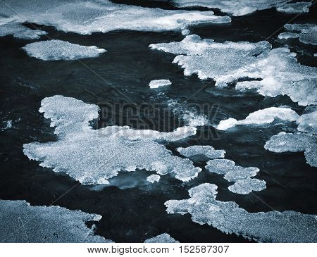 abstract dark background ice formation on freezing river