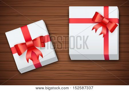 Gift boxes on brown wooden table. Top view. Winter Holiday xmas background and backdrop. Fairy style. Vector Illustration.