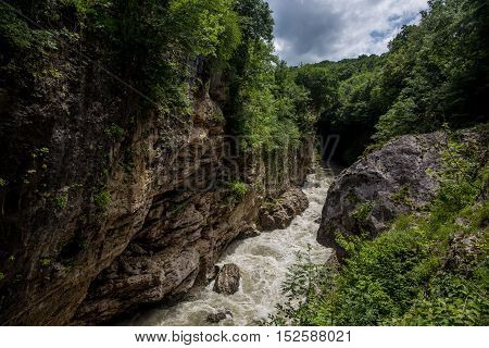 Russia , the Republic of Adygea . Rough river Belaya (White) in Khadzhokhsky gorge, summer