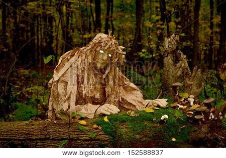 wood goblin with white eyes in the night forest forestry monster