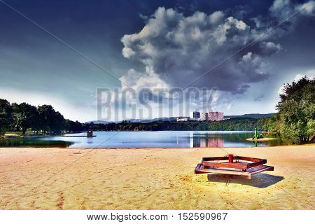 Empty Carousel On The Sandy Beach Of Alum Lake Kamencove Jezero In Chomutov  At The End Of The Summe