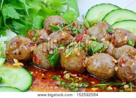 Grilled beef meatballs with sweet and spicy sauce. (soft focus,lens blur) Popular street foods.