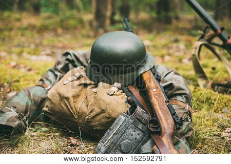 German Military Ammunition Of World War II On Ground. Military Helmet, Lights, Rifle