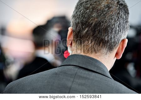 Detail with a bodyguard wearing in ear headset