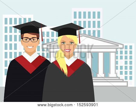 girl and boy in gown graduate on the background of the university
