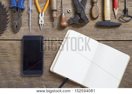 Various tools mobile phone and the blank notebook