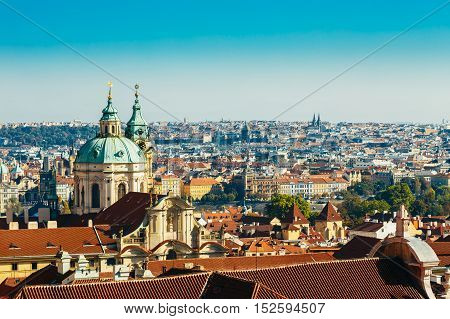 Aerial View Of Cityscape And St. Nicholas Church In Prague, Czech Republic.
