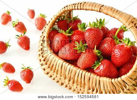 close up from strawberries in basket on white background.