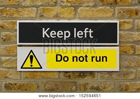 Keep Left and Do Not Run Sign at Wall
