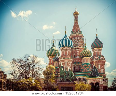 Temple of the Intercession on the Moat known as St. Basil's Cathedral on Red Square in Moscow Russia in sunny summer day toned image with vignette