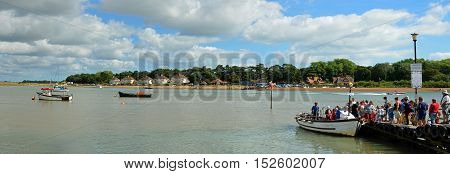 FELIXSTOWE, SUFFOLK, ENGLAND - AUGUST 29, 2016: A Panorama of to many people trying to board the ferry to cross the river Deben at Fekixstowe Ferry.