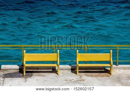 Two Yellow Benches in the Curacao Harbor