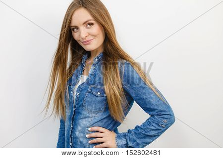 Fashion jeans people concept. Smiling lady with nice shirt. Girl is wearing denim clothes.