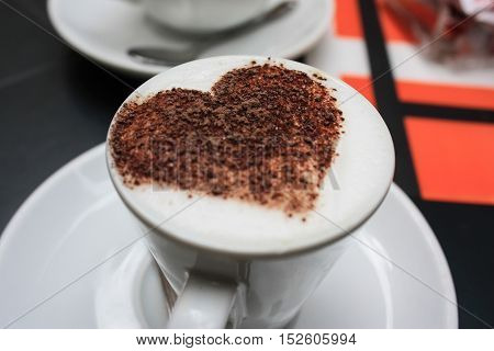 A cup of espressiono decorated with a heart in South Italy