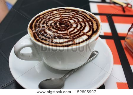 A cup of cappucciono on the table
