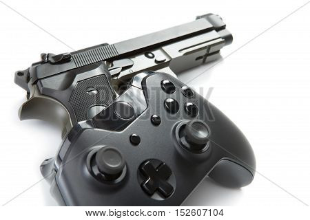 Game Controller Over A Real Handgun - Studio Close Up Shot. Virtual And Real Life Concept