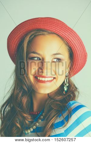 Portrait of young beautiful brunette woman in hat