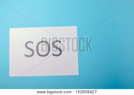 Word Sos Written On Paper