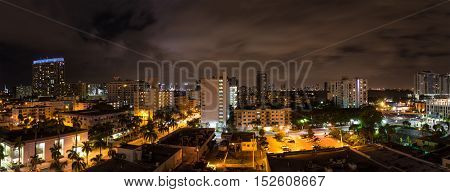 Panoramic night shot of Miami Beach Florida with Downtown Miami in the background.