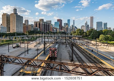 Chicago Skyline with commuter train along railroad tracks