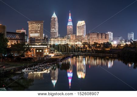 Cleveland city skyline at night across the Cuyahoga river