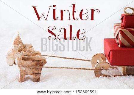 Moose Is Drawing A Sled With Red Gifts Or Presents In Snow. Christmas Card For Seasons Greetings. English Text Winter Sale