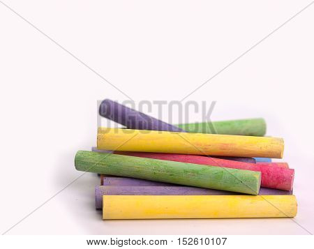 chalks in a variety of colors Placed on a white background.