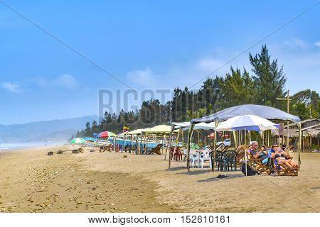 SANTA ELENA, ECUADOR, OCTOBER - 2015 - Sunny day scene at crowded beach at Olon Santa Elena province Ecuador